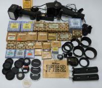 Nikon camera accessories to include MD-12 auto winder, SU-11 and SB-14 speedlight, lens hoods