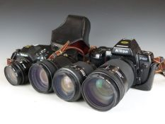 Two Nikon SLR cameras comprising F-501 and F-801, with four Nikon lenses, comprising 24mm 1:2.8,
