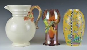 A group of 20thC ceramics including Clarice Cliff jug, Wilkinsons lustre pedestal vase decorated