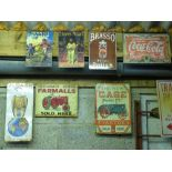 Nine metal advertising signs including Case, Farmalls and Brasso,approximately 40 x 30cm
