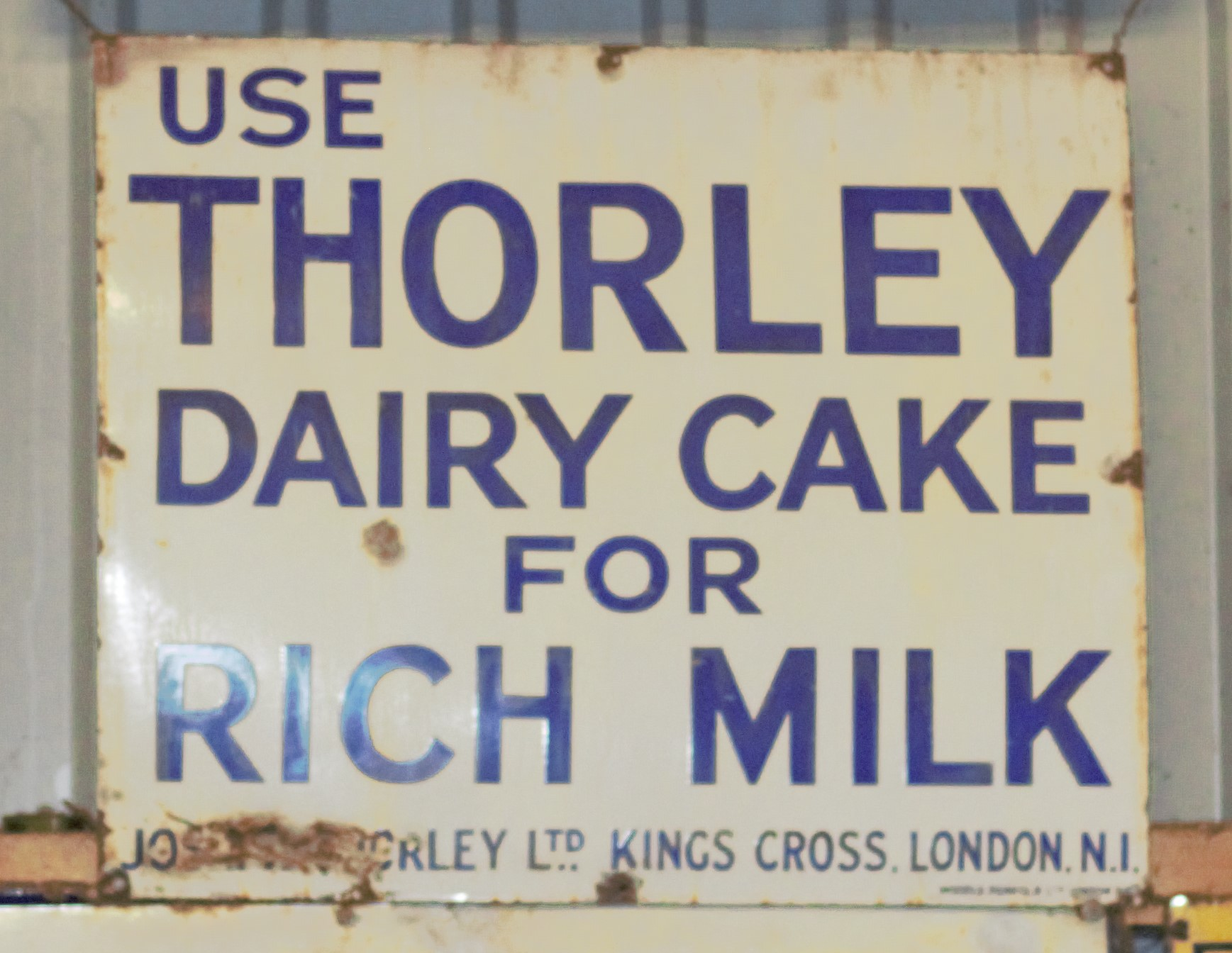 Vintage enamel advertising sign 'Thorley Dairy Cake', 68 x 81cm