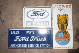 Three enamel advertising signs comprising Ford Tractor, J I Case & Ford Truck, largest 20.5 x 46cm