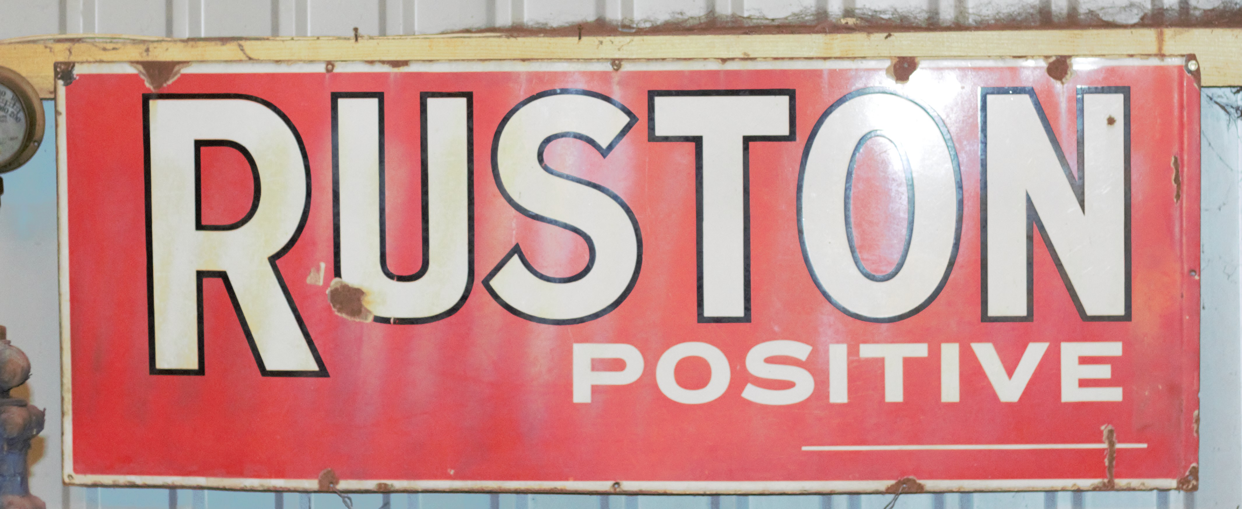 Vintage enamel advertising sign 'Ruston Positive' (possibly Ruston Bucyrus or Ruston Hornsby