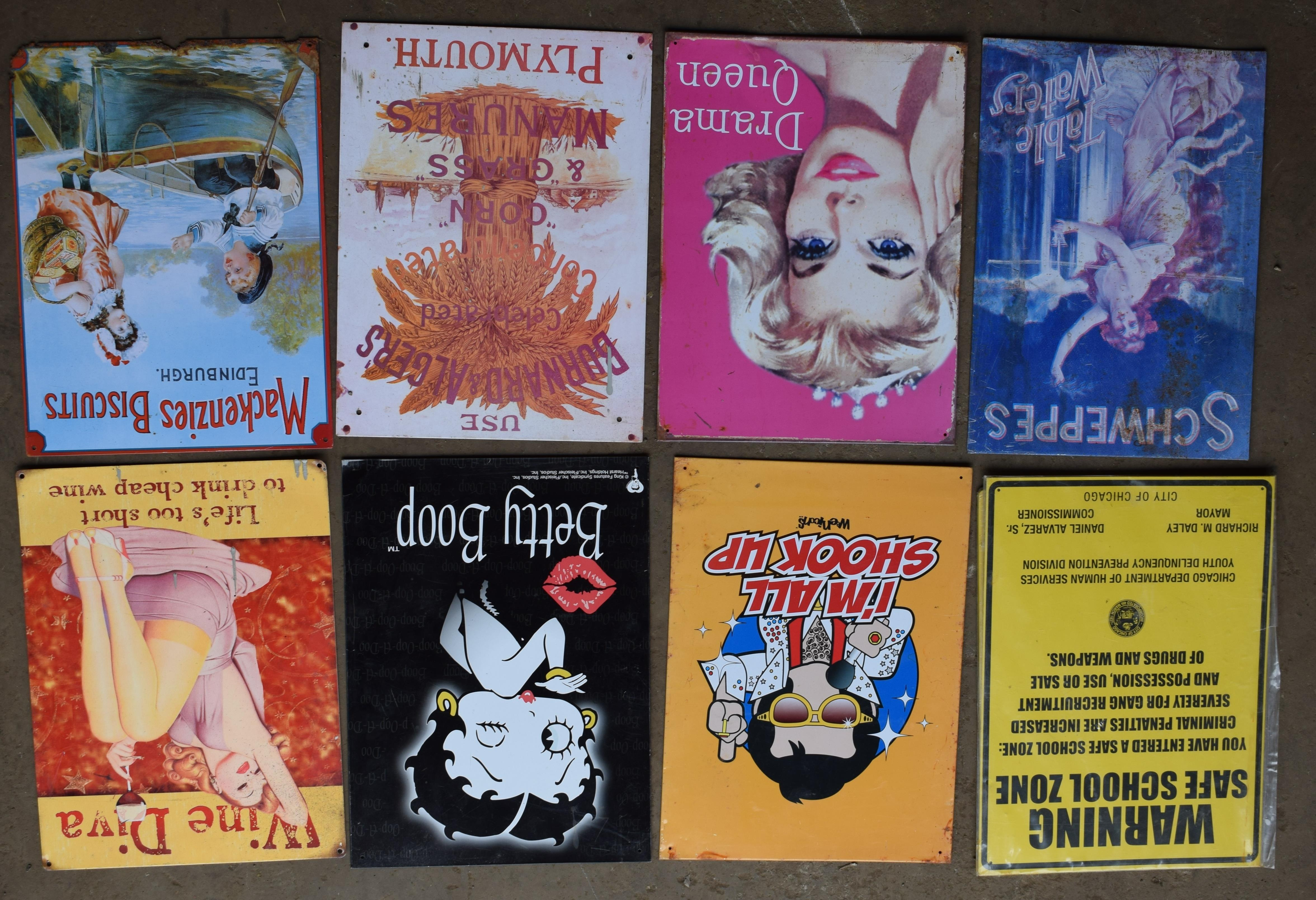 Eight metal advertising signs to include Betty Boop, biscuits, school, Schweppes etc, each