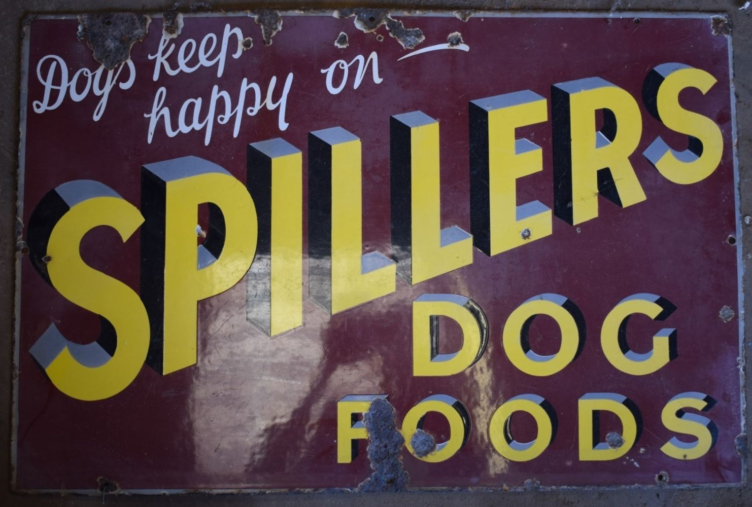 Auction of enamel/ advertising signs & vintage tractors