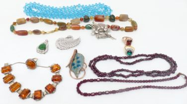 A collection of costume jewellery including garnet necklace, silver ring, agate necklace, pressed