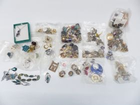 A collection of jewellery including necklaces, earrings, etc