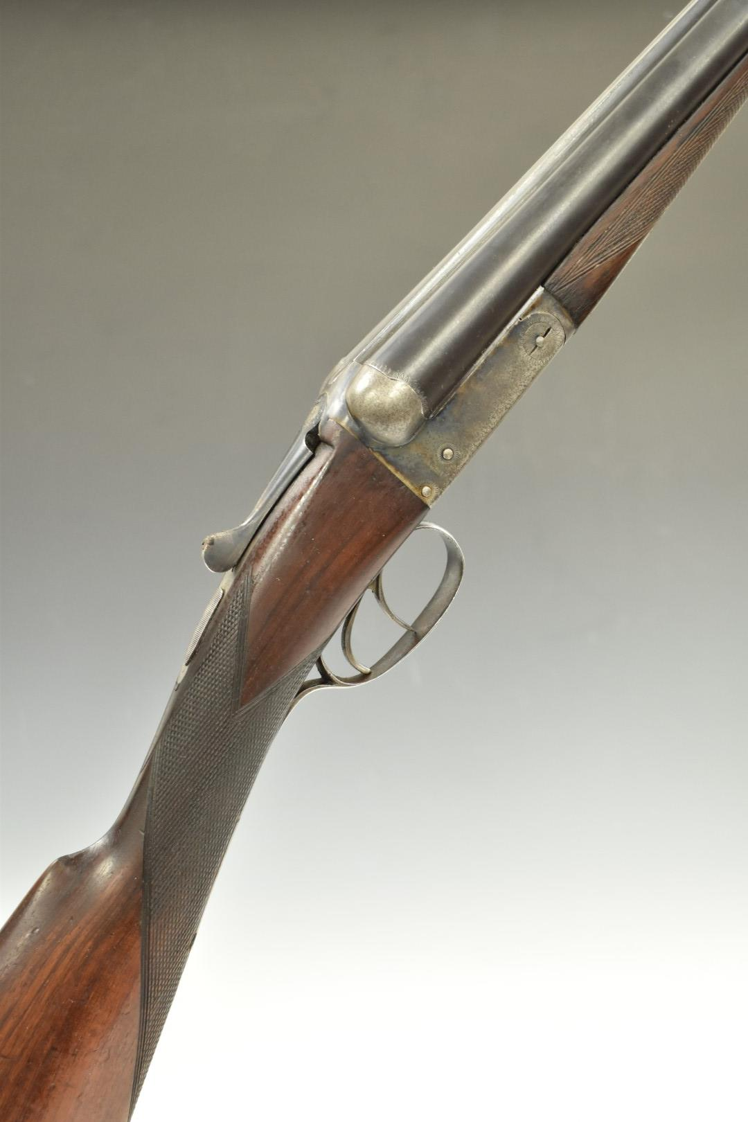 Two 12 bore side by side shotguns, each with engraved locks, trigger guard, underside and thumb