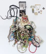 A collection of costume jewellery including beads, brooches, necklaces including Navajo, silver