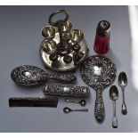 Hallmarked silver mounted dressing table items comprising hand mirror, two brushes and comb,