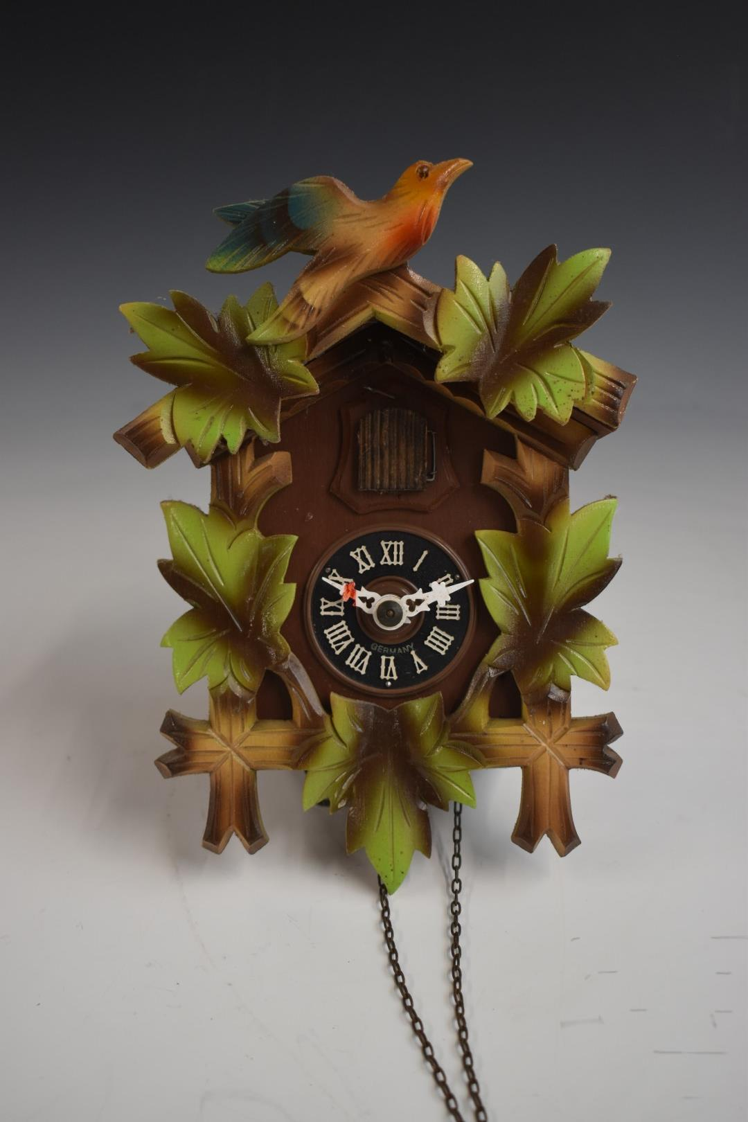 A c1970s two train cuckoo clock in painted case, with two weights, H22cm - Image 2 of 3