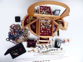 A collection of costume jewellery including silver cross, bracelet and rings, watches, pendants,