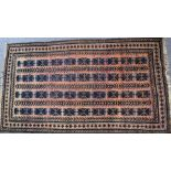 Turkoman rug with four rows of nine guls on a wine ground, 197 x 111cm