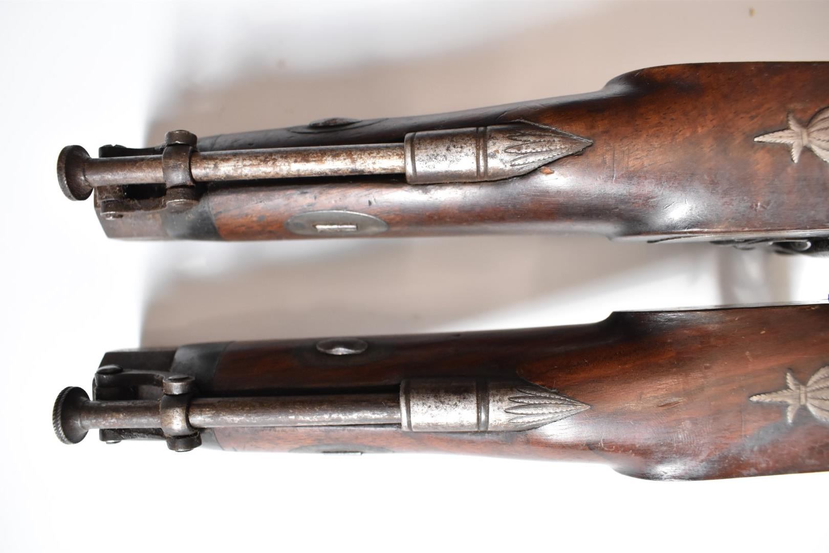A pair of percussion hammer action pistols with locks signed 'Backwell Devonport', ornately engraved - Image 11 of 11