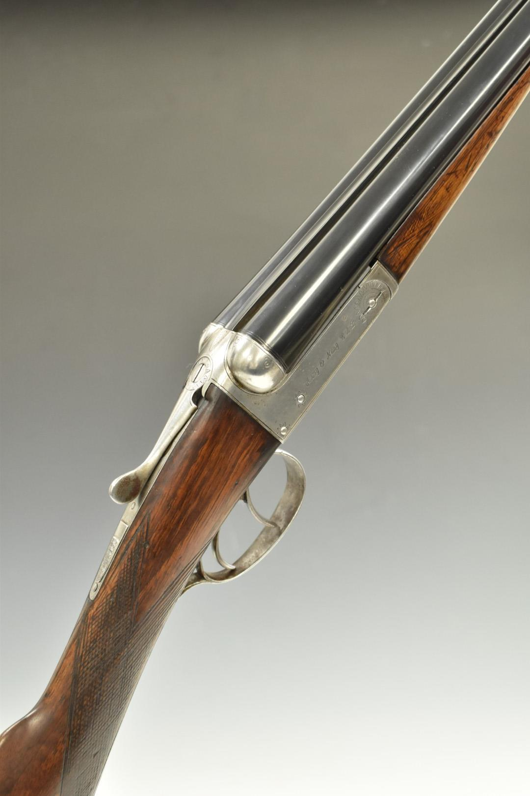 Army & Navy 20 bore side by side shotgun with line engraving to the named locks, trigger guard,