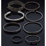 Four silver bangles, two christening bangles and a filigree bangle