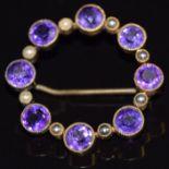 Edwardian 9ct goldbrooch set with round cut amethysts and seed pearls, 5g, 3.2cm