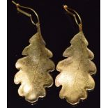 A pair of 14ct gold earrings in the form of an oak leaf with textured decoration, 14g