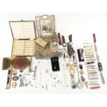 A collection of costume jewellery including brooches, silver topped bottle, silver edged
