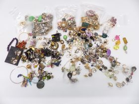 A collection of vintage earrings, vintage swallow brooch, etc