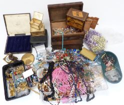 A collection of costume jewellery including vintage necklaces, Art Deco crystal necklace, beads, etc