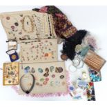 A collection of costume jewellery including beads, enamel copper pendants, large silver necklace,