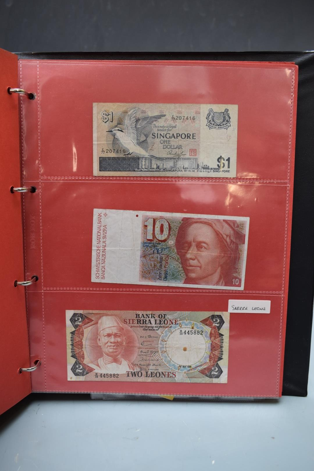 An amateur collection of world banknotes in two albums including Bank of Ireland, some used, many in - Image 13 of 13