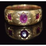 Victorian yellow metalring set with three rubies in star settings (5g), in Saqui & Lawrence ring