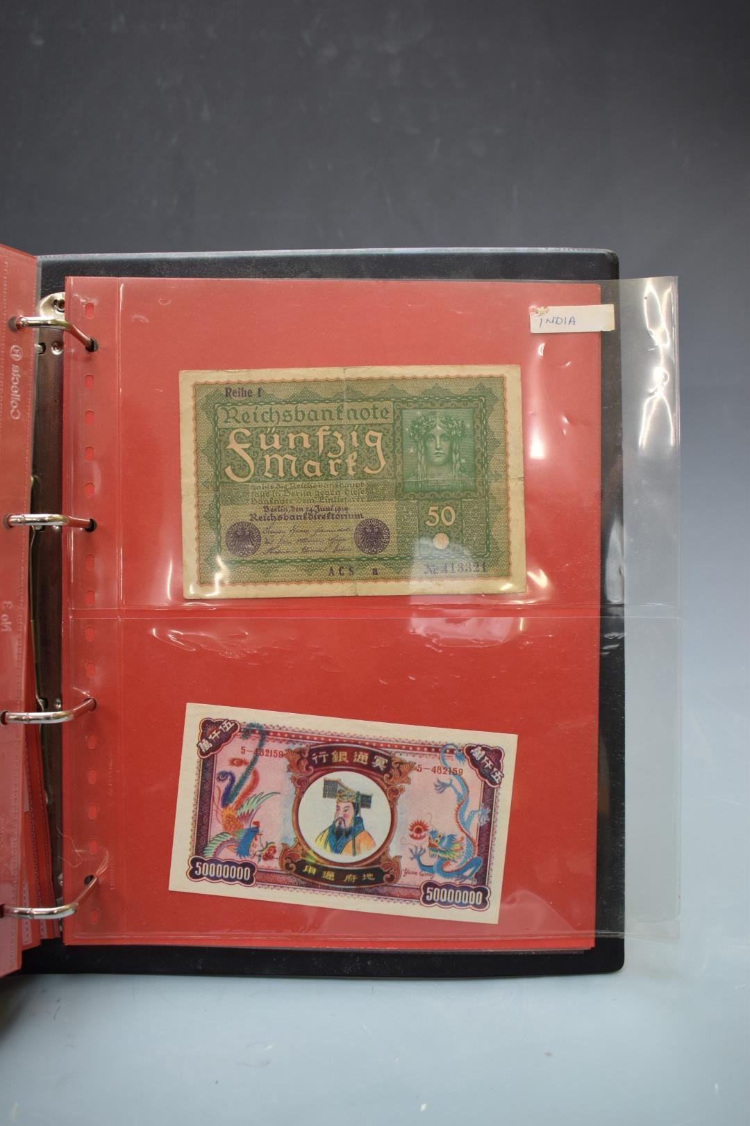 An amateur collection of world banknotes in two albums including Bank of Ireland, some used, many in - Image 7 of 13