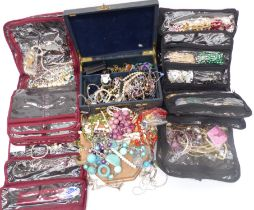 A collection of costume jewellery including peridot necklace, beaded necklaces, bracelets,
