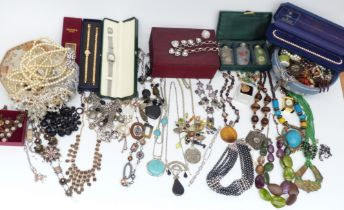 A collection of costume jewellery including Armani Exchange necklace, other necklaces, etc