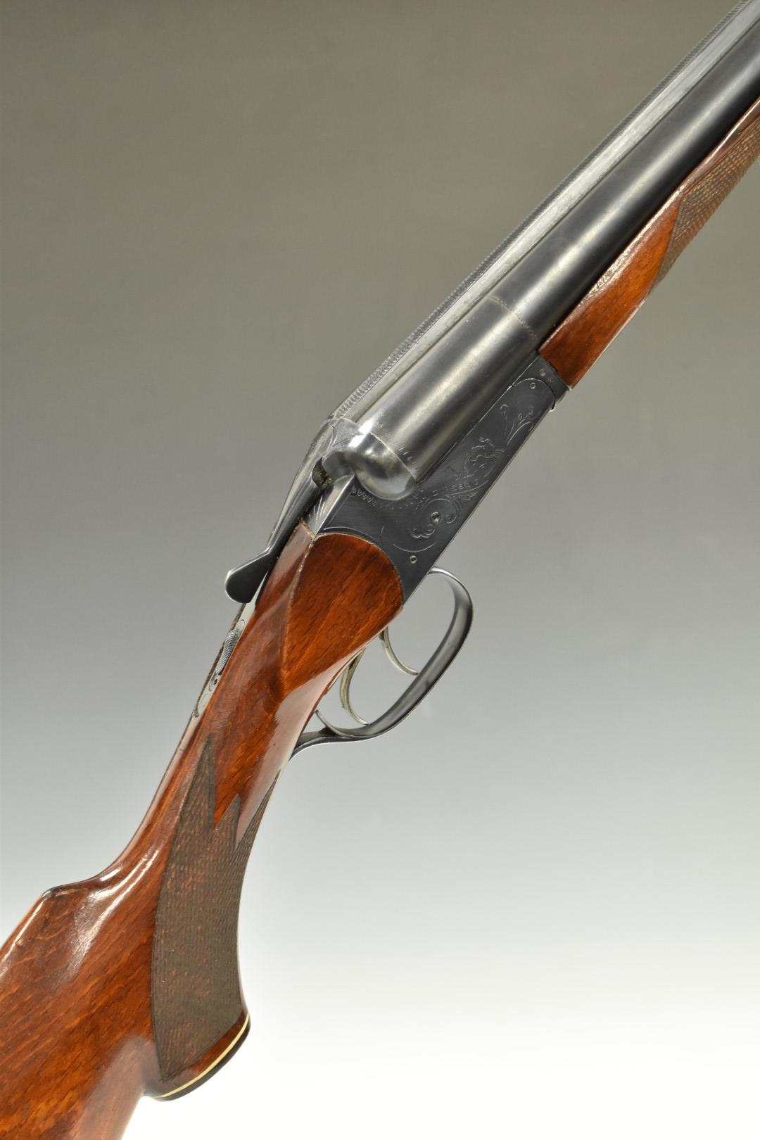 Baikal IJ-58-M 12 bore side by side shotgun with heavy engraving of dogs to the locks, chequered