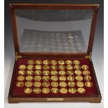 """Cased set of gold plated bronze medallions """"The World's Greatest Sculptures"""", in glazed display"""