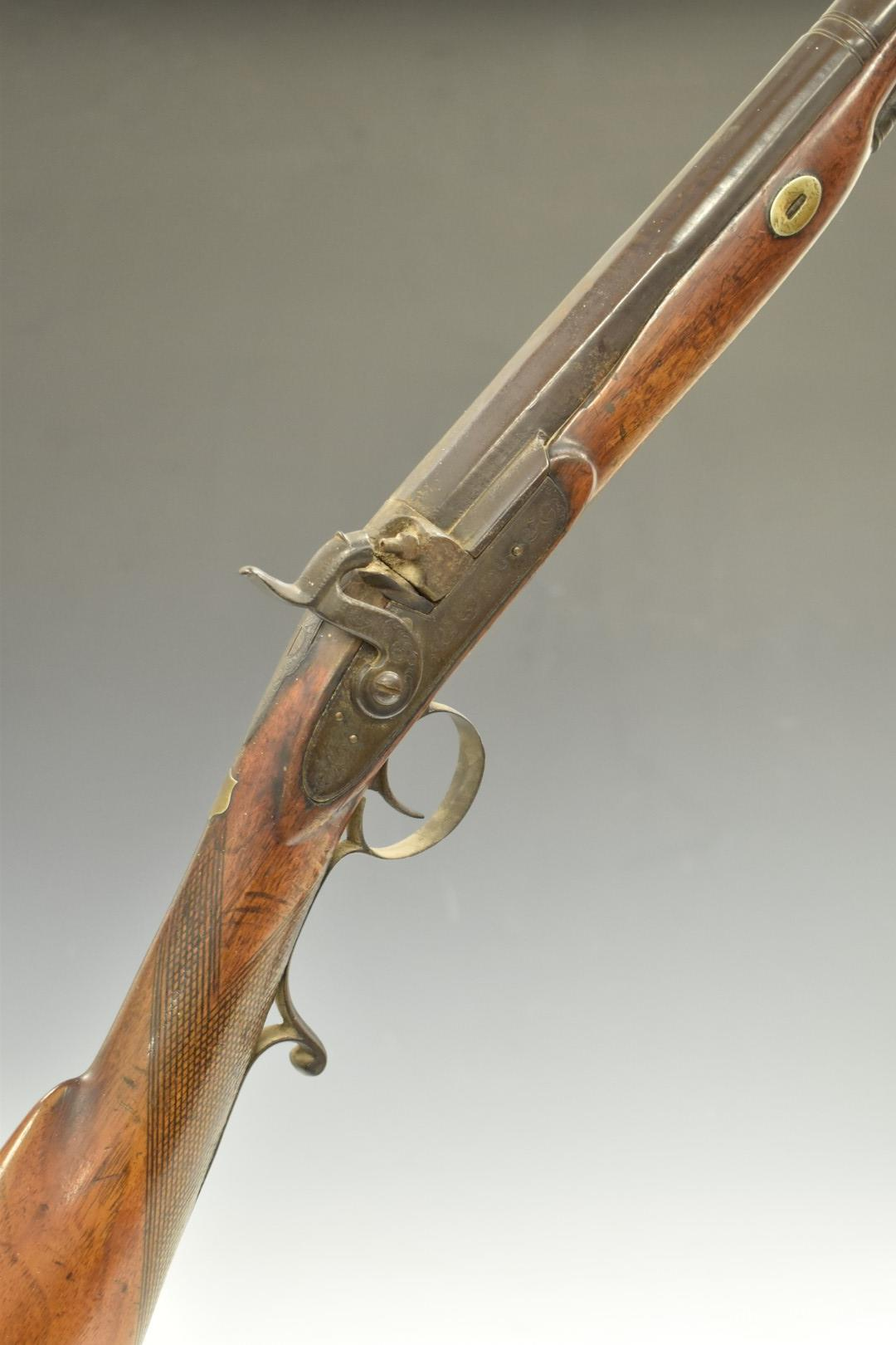Unnamed percussion hammer action sporting gun with engraved lock, hammer top plate and scrolling