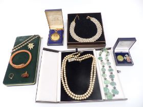 A collection of costume jewellery including two silver brooches, Art Deco snake bangle, necklaces
