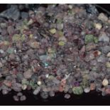 A quantity of loose rough sapphire, ruby and garnet