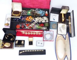 A collection of jewellery including brooches, earrings, necklaces, etc