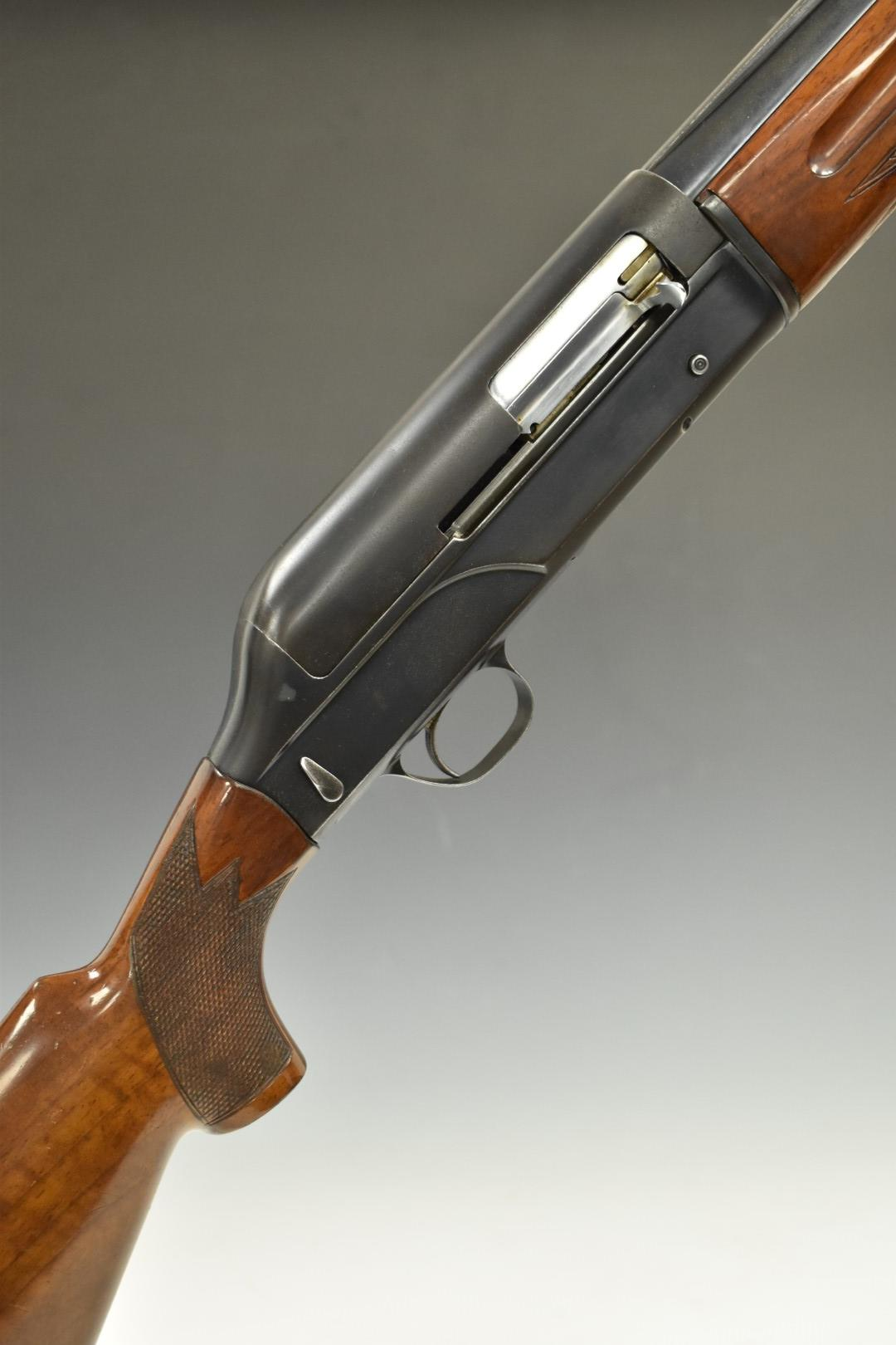 Breda 12 bore four-shot semi-automatic shotgun with chequered semi-pistol grip and forend, vented