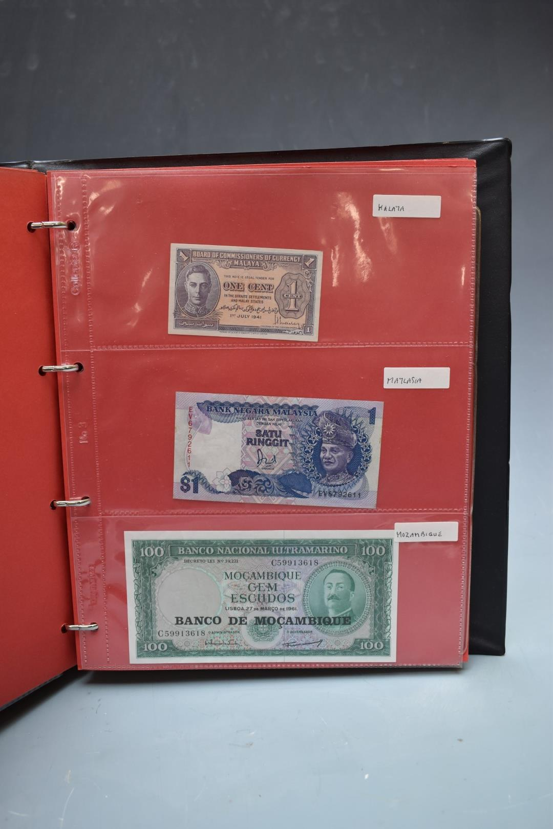 An amateur collection of world banknotes in two albums including Bank of Ireland, some used, many in - Image 11 of 13