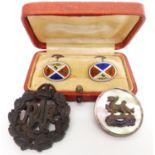 A pair of silver cufflinks set with enamel, an RAF brooch, and an RAF badge