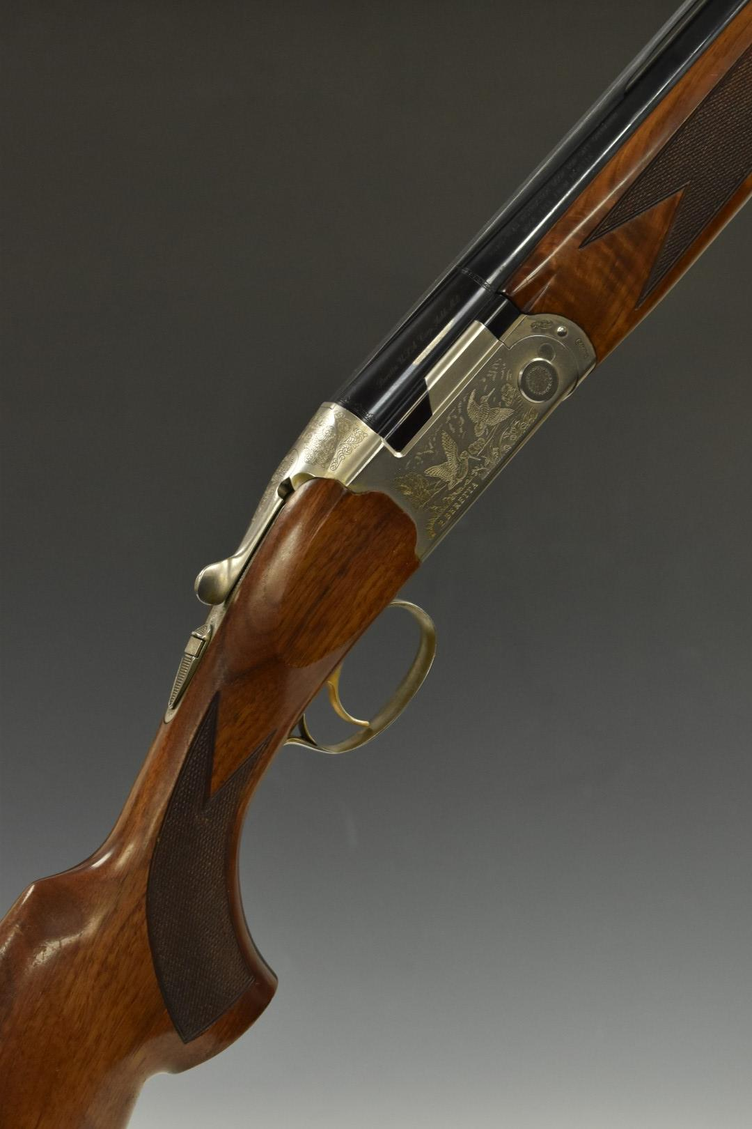 Beretta Ultra Light 12 bore over and under ejector shotgun with engraved scenes of birds to the