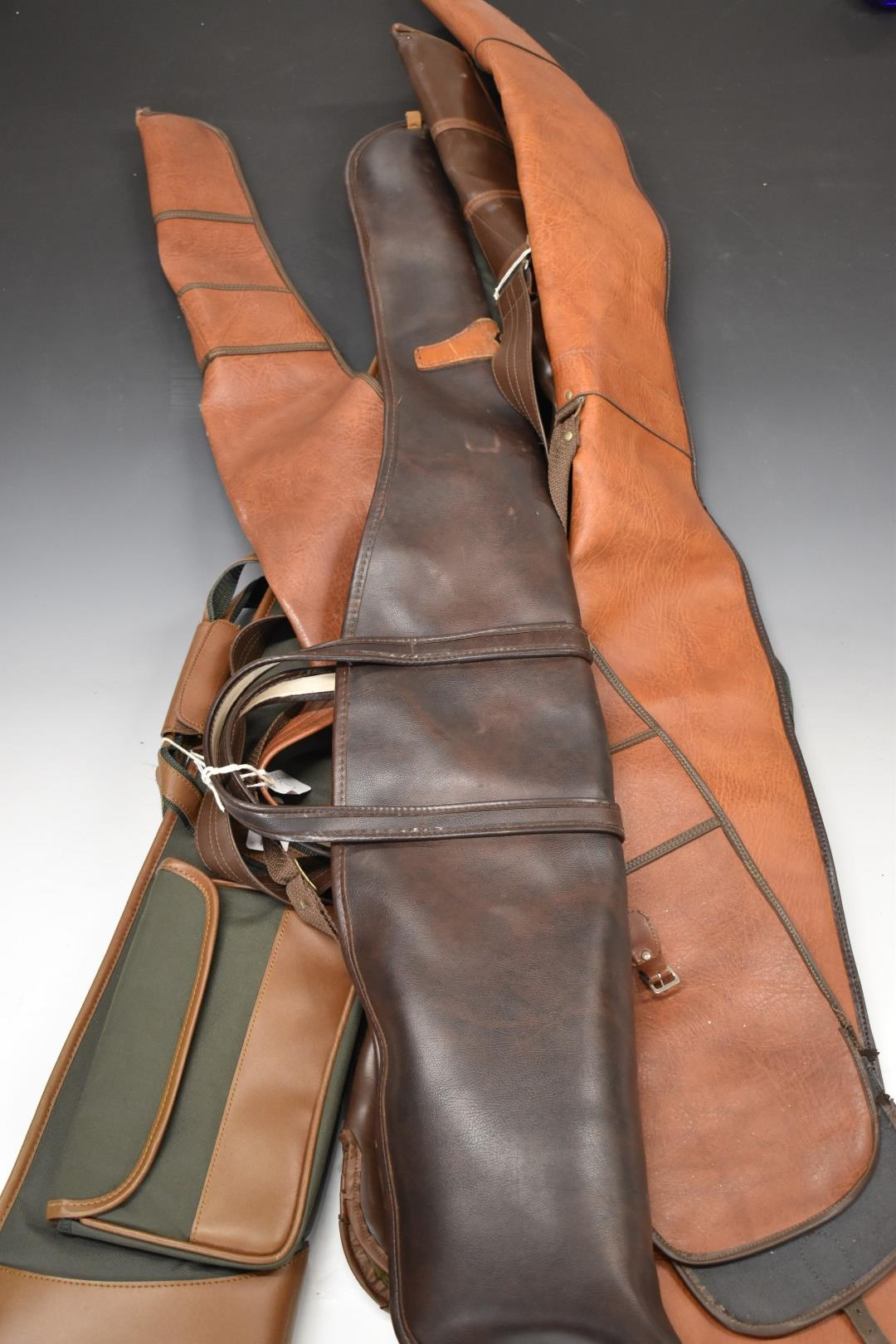 Six various shotgun or rifle slips including leather examples, some with wool linings.