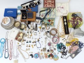 A collection of costume jewellery including beads, Sphinx brooch, silver ring, etc