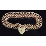 A 9ct gold double strand curb link bracelet made from a Victorian fob chain, with heart padlock,