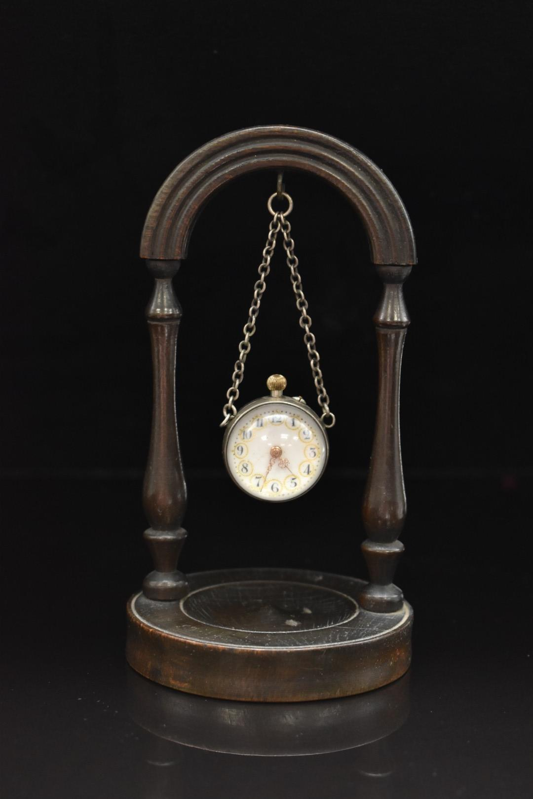 19th or early 20thC fob watch with exhibition glass front and Essex crystal rear depicting a bird on