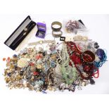 A collection of costume jewellery including earrings, necklaces, etc