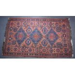Turkoman rug decorated with three large blue guls on a wine ground, 310 x 192cm