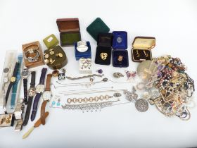 A collection of costume jewellery including necklaces, brooches, silver necklace and earrings,