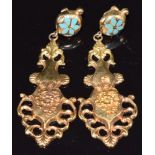 A pair of yellow metal earrings set with enamel and with embossed floral decoration, 4.6g