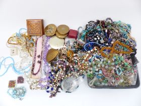 A collection of costume jewellery including vintage necklaces, beads, enamel buckle, enamel pot,